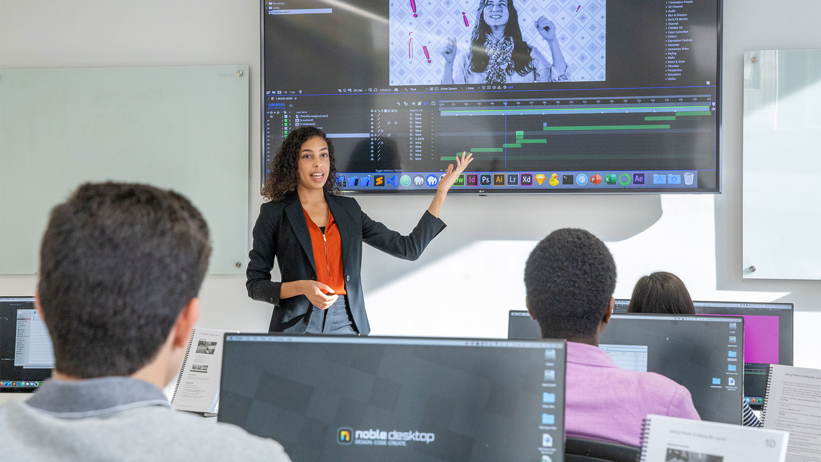 Video editing instructor leading class